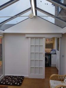 High Level Conservatory Shelf With Sliding Door Enclosure