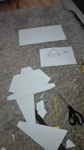 Drawing the Plans on the Cardboard and Cutting It Out.