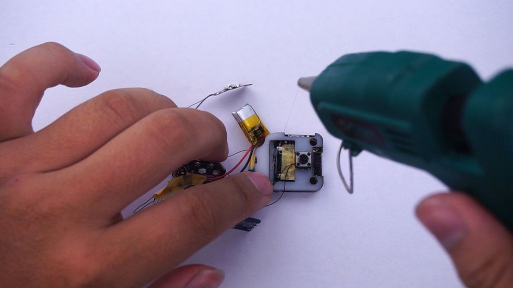 Picture of Fix the Battery to the Slot in the Back Cover With the Hot-melt Adhesive