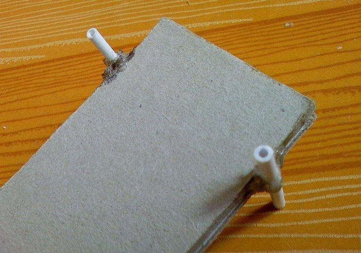 Picture of Step 4: Fix a Part of the Two Used Refills on Both Sides of the Chassis With Hot Melt Adhesive