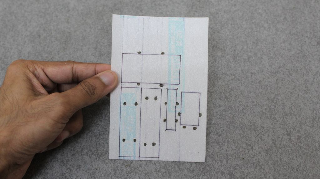 Picture of Fixing the Circuits on Glass Fiber Sheet