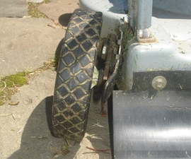 Repair a sagging or broken lawnmower wheel