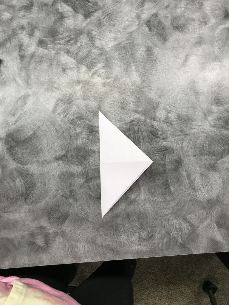 Picture of Step 7: Unfold. Fold Top Peak to Middle Point.