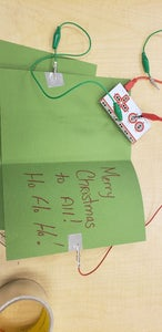 Attach Your Makey Makey Alligator Clips to Each Side of the Card.