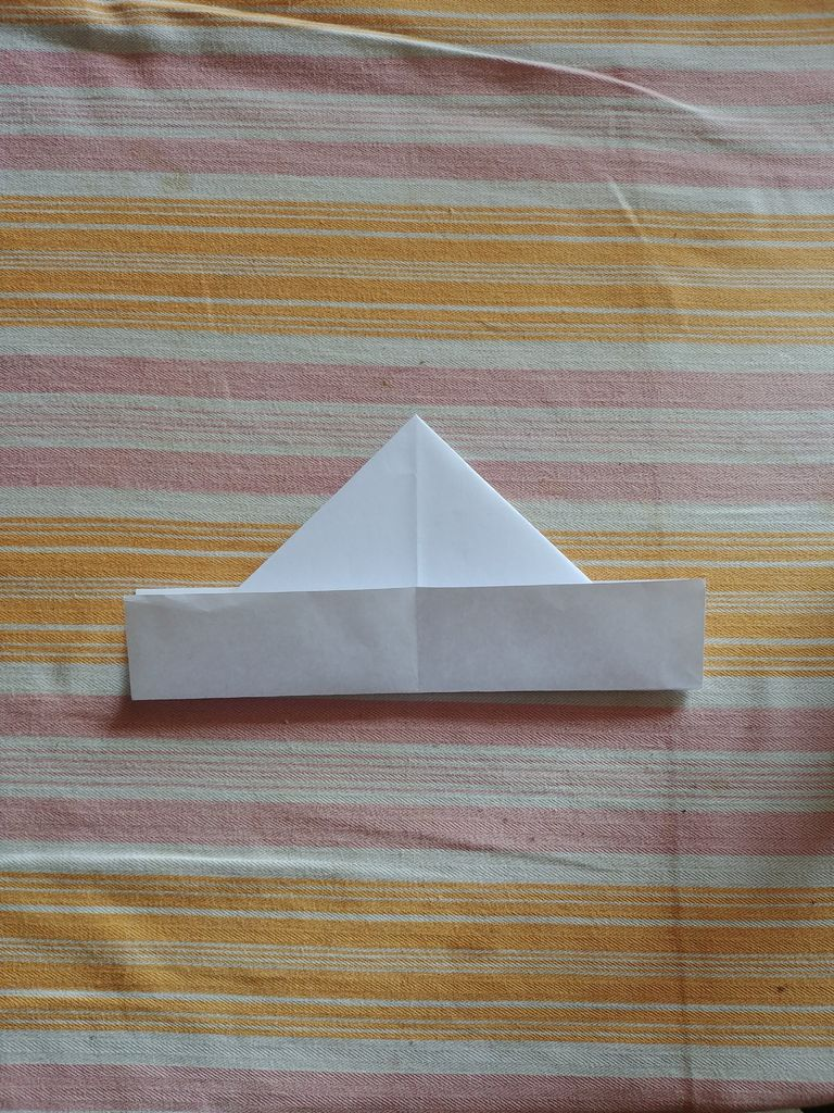 Picture of Fold the Edges Over the Triangle.