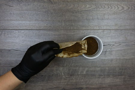 Transfer Coffee Grounds to a Mixing Cup