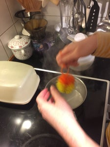 Make the Pom-poms Extra Fuzzy by Holding Them Over a Pot of Boiling Water