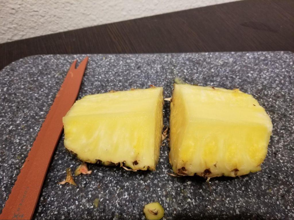 Picture of Cut Pineapple Quarter in Half.