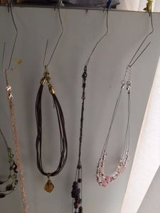 Unbend the Paper Clips; Wrap One End of Each Around a Pushpin, and Use the Other As a Hanger!