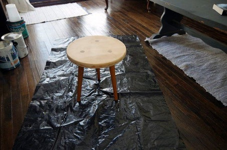 Three Legged Stool Makeover: Paint and Stain Combo With Dipped Legs