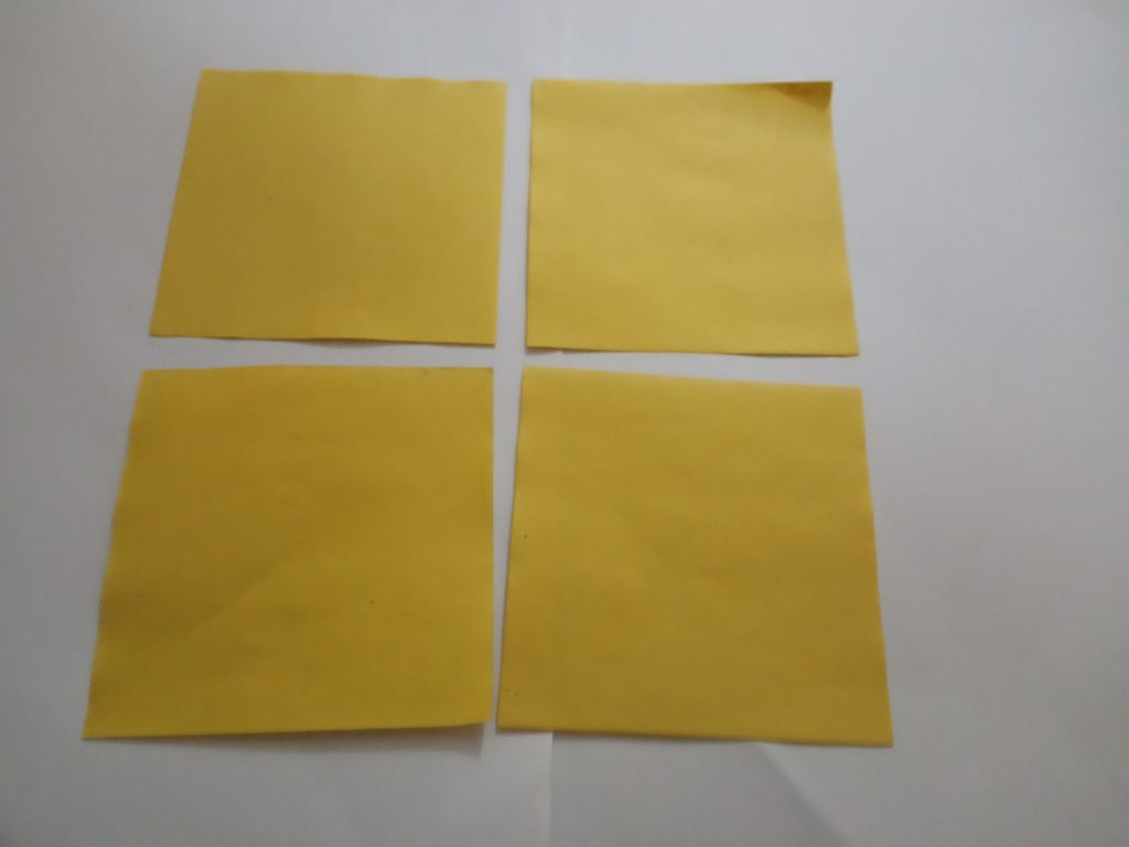 Picture of Take an A-4 Sized Sheet of Paper. Cut It Into 4 Equal Square Pieces.