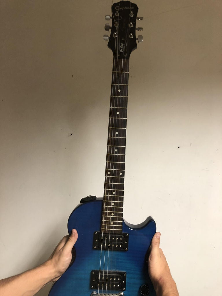 Picture of Take Old Strings Out of Guitar