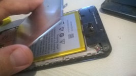 Use the Screwdriver to Get to the Battery