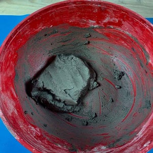 MIX THE CEMENT AND BLACK PIGMENT