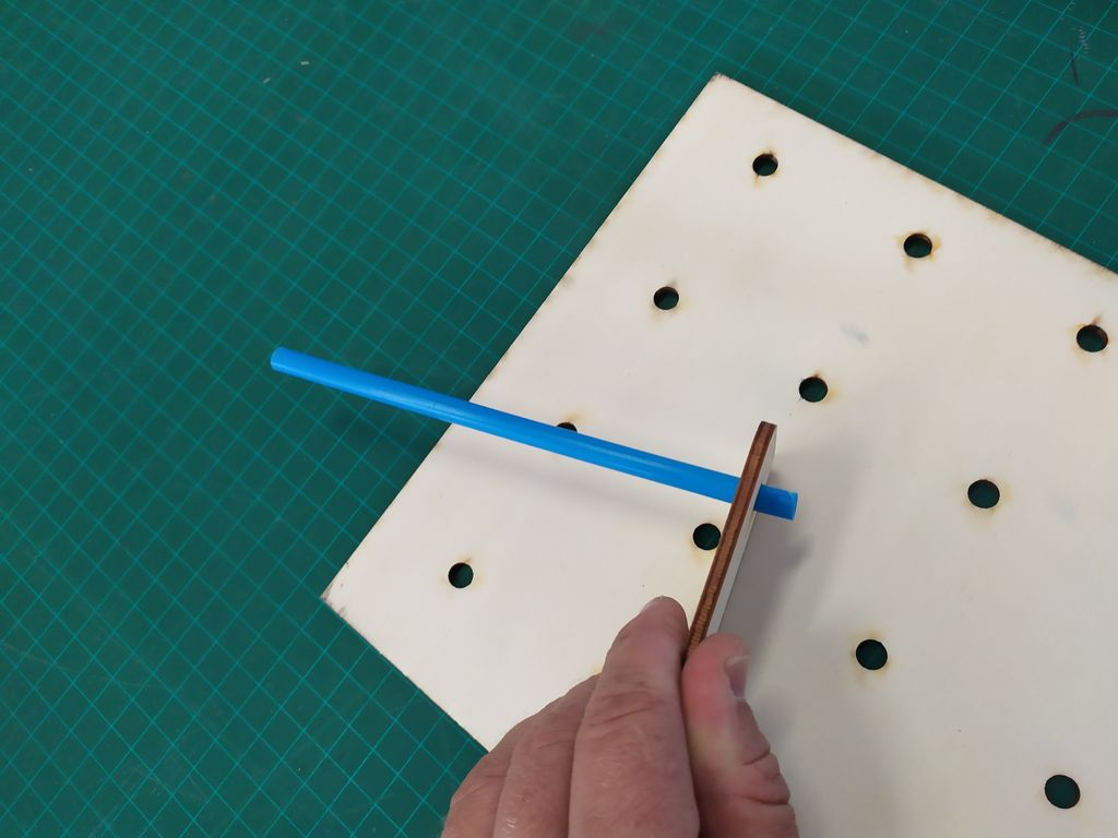 Picture of Assembly of the Tiles - Inserting the Pegs (plastic Straw):
