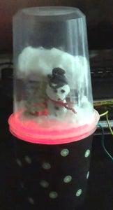 Making Music and Light Beneath the Snow Globe