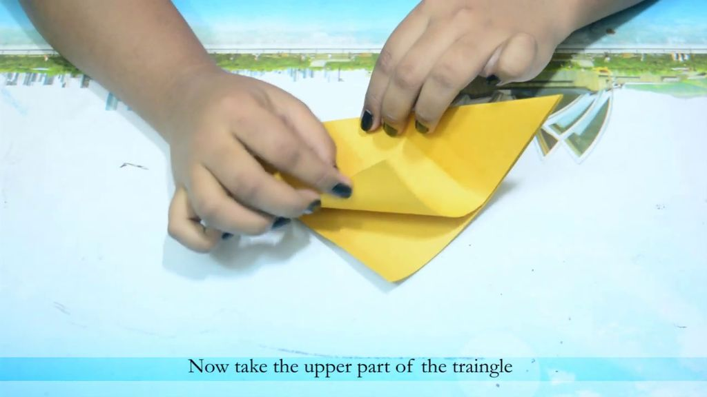 Picture of Take the Top of the Triangle and Fold It to the Base