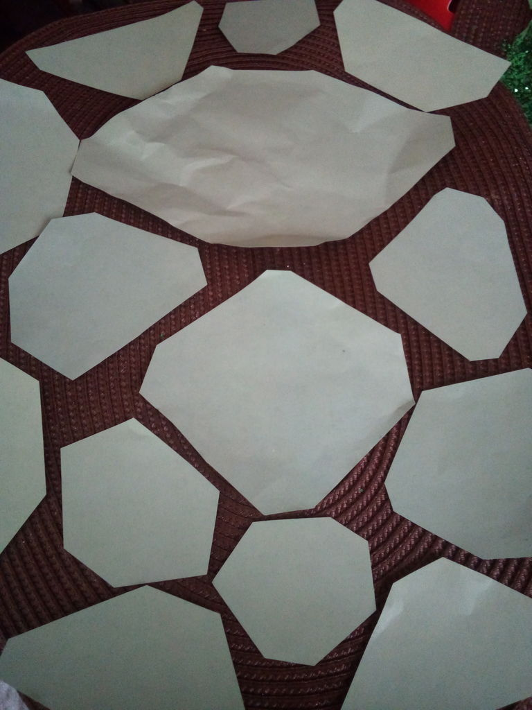 Picture of Cut Out Hexagon Shapes Using Green Construction Paper and Glue Them On.