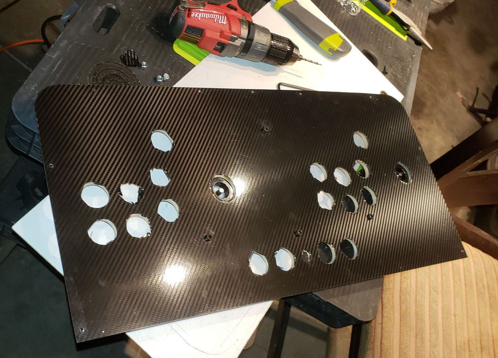 Picture of Tapping Control Panel Screw Holes, Attaching Plywood Base and Applying Vinyl