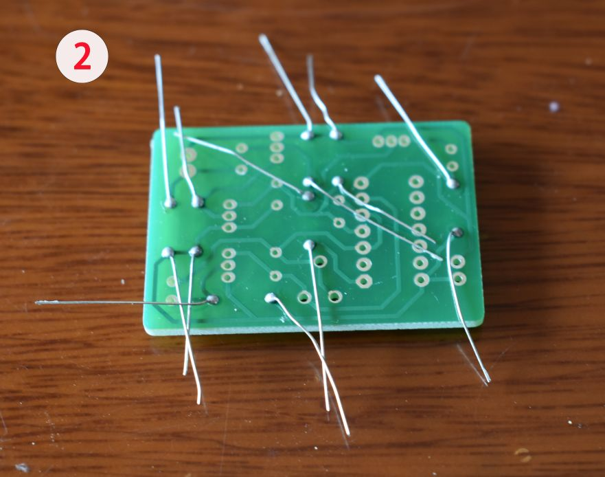 Picture of Solder the Resistors to the PCB