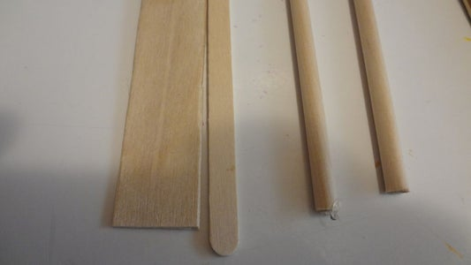 Using Craft Sticks and Dowels to Build the Frame and Fasten Images Between.