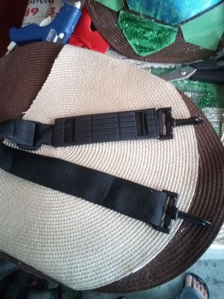 Picture of Determine Where Your Strap Will Hook In.  Carefully Poke a Hole Through the Placemat and Hook the Strap in Place.