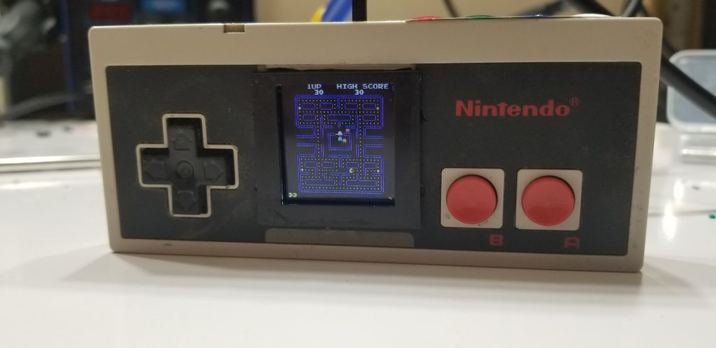 Picture of Arcade Machine in an NES Controller.