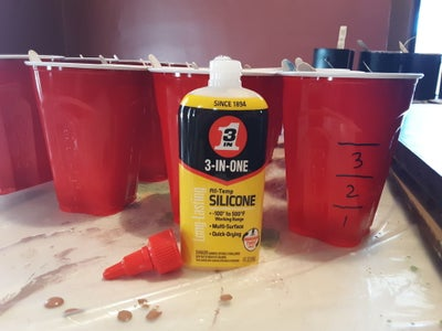 Spread Out Your Red Solo Cups.  Place One Stir Stick in Each Cup.