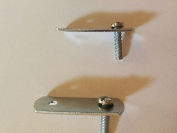 Place Screw on Monitor, With Washer and Metal Junction