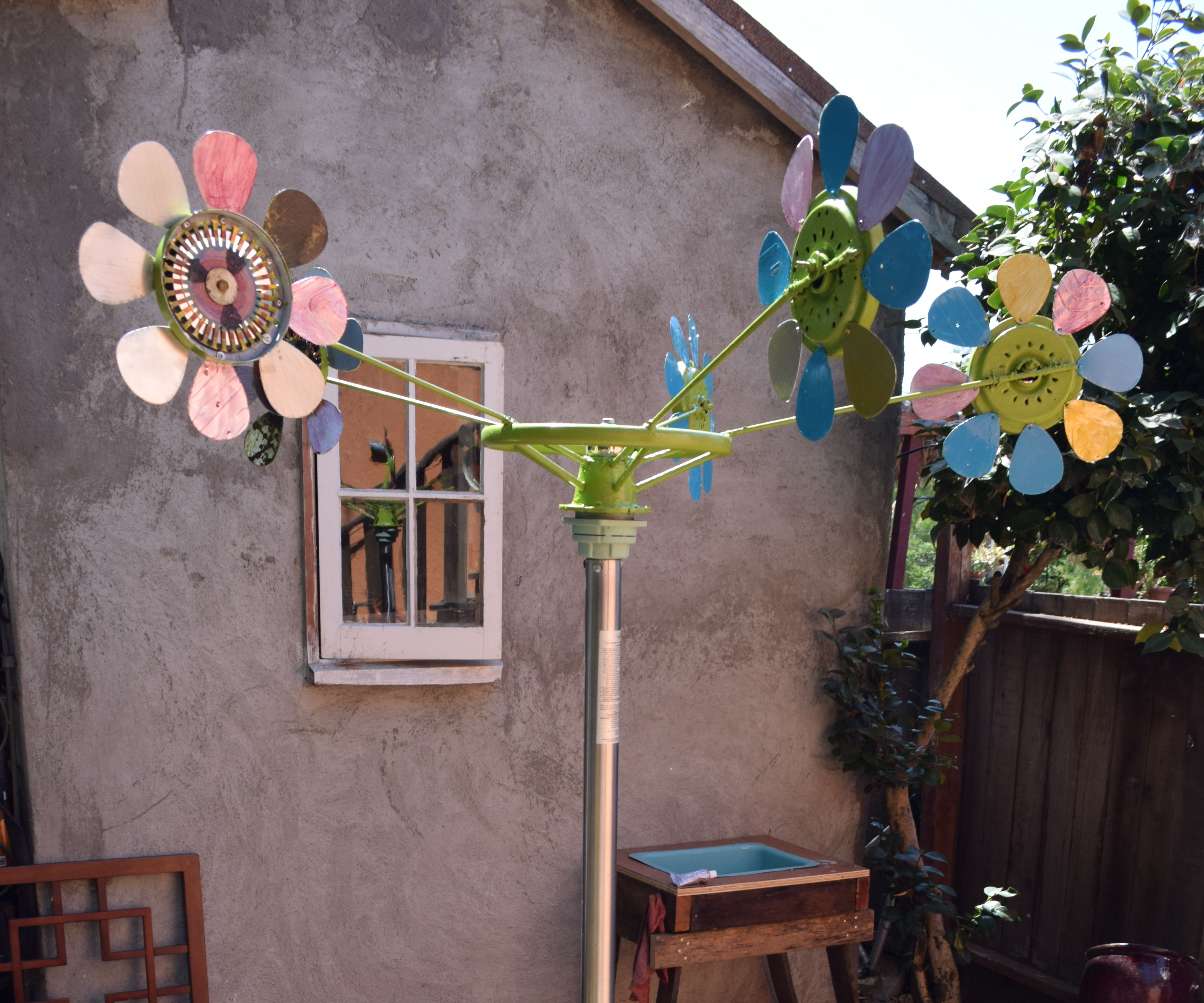 Recycled materials wind catcher yard art