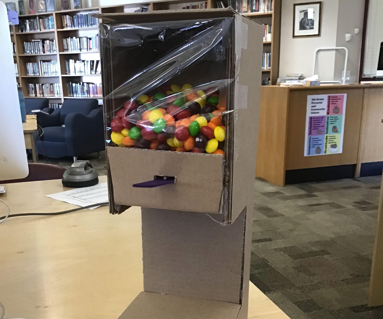 A Cardboard Candy Dispenser