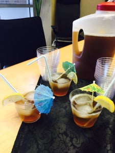 Finish Decorating Cups With Straws & Party Umbrellas