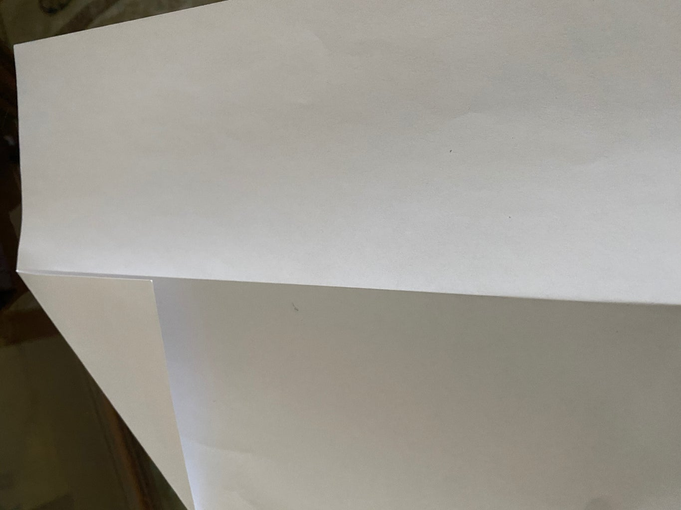Step 2: Unfold the Paper and Fold the Corner