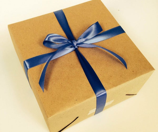 How to Gift Wrap (using 3 Pieces of Tape!)