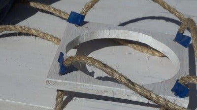 HOW TO THREAD THE ROPE THROUGH THE WOODEN BASES