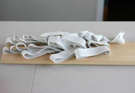 Staple the Elastic to the Board