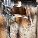 Storing a Grease Gun Without the Mess.