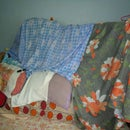 FORT MADE OF BED, COT, PILLOW AND SHEET