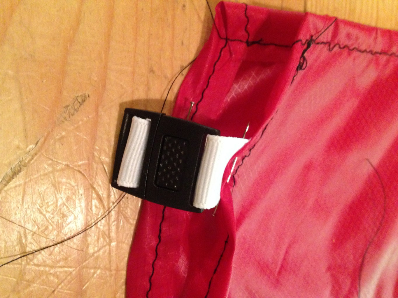 Step 4: Add the Center Release Buckles to the Top of the Quilt
