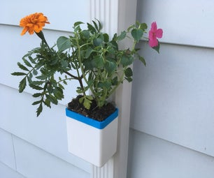 Self-watering Downspout Planter