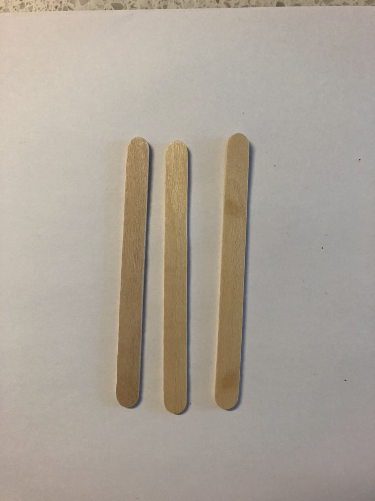 Tape the Three Popsicle Sticks Together to Create a Board.