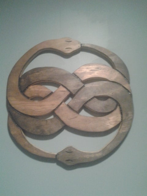 The Never Ending Story Symbol of Auryn Carved / Burnt Wall Hanging