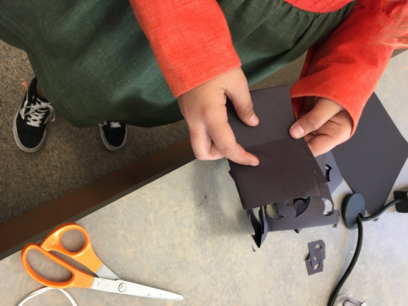 Fold the Black Construction Paper in Half.