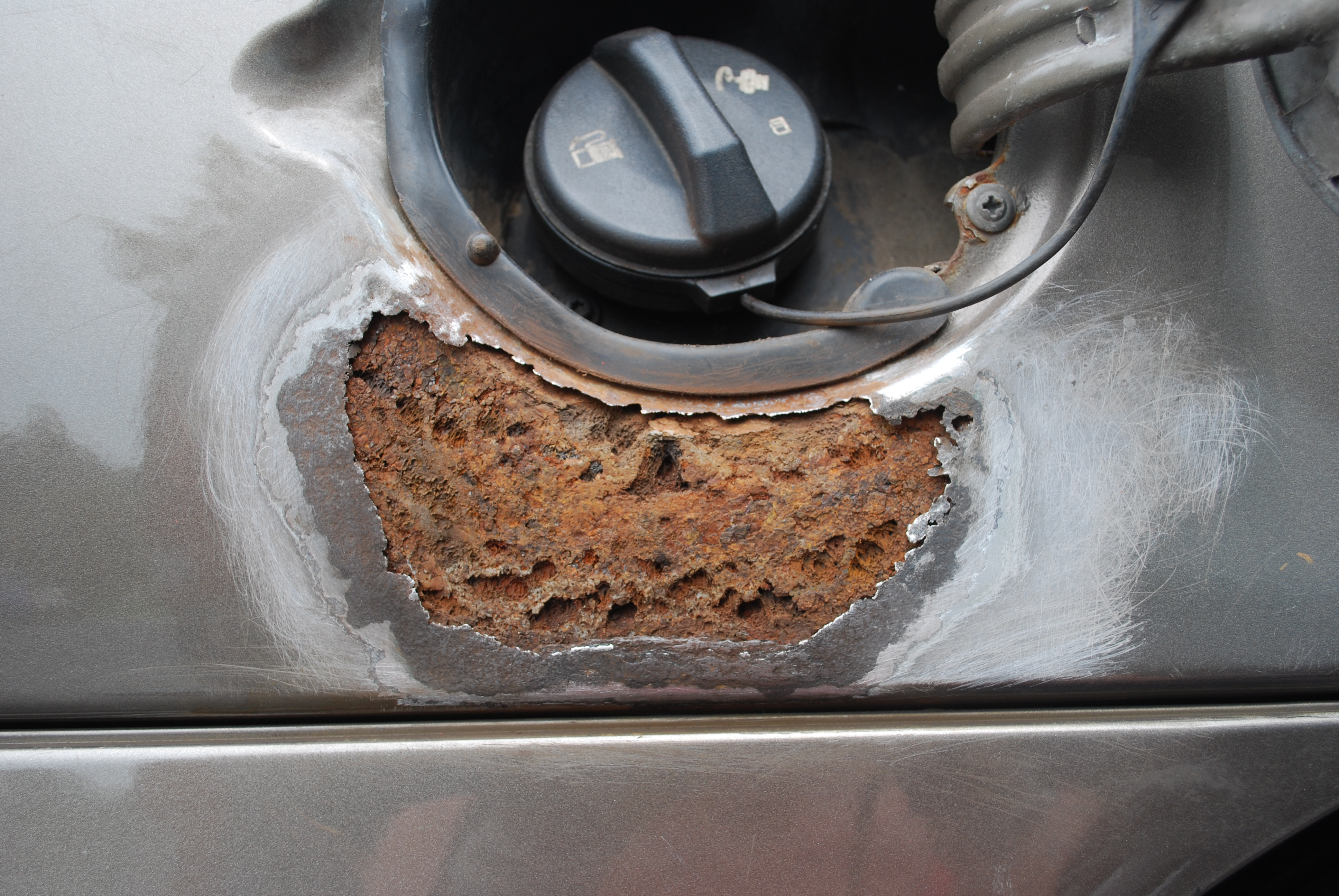 repairing a rust hole in a car
