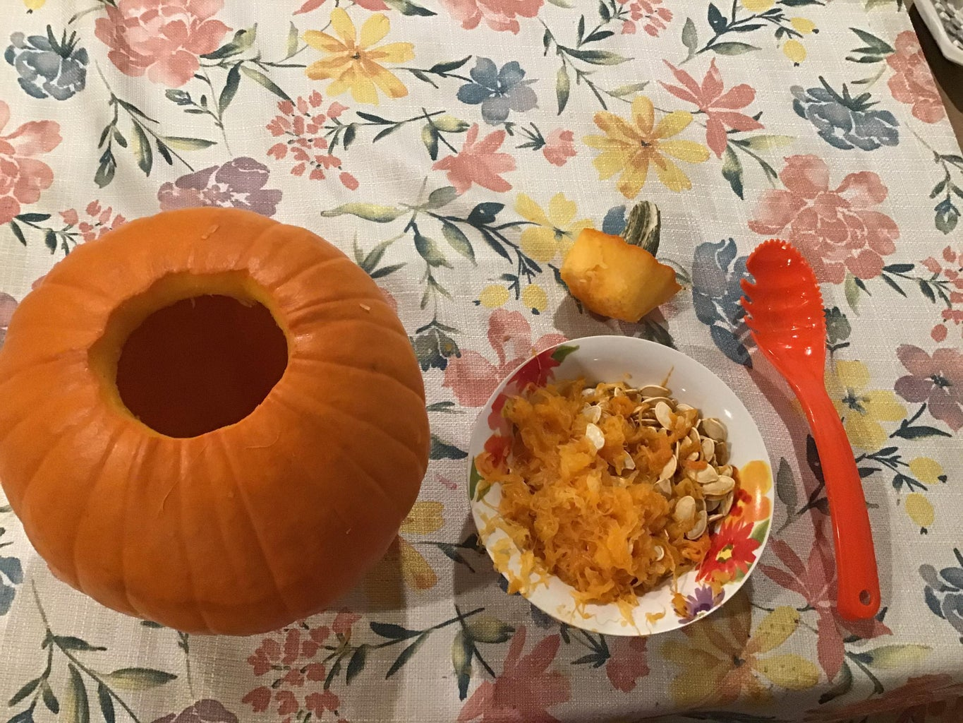 Scooping Out the Seeds From the Pumpkin. Warning Will Get Messy!!!!