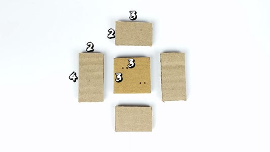 Take Cardboard Pieces of the Given Measurements to Form a Box, and Make Holes As Shown.