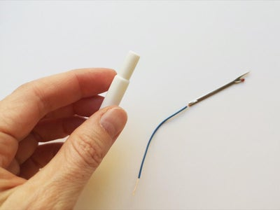Step 2: Push the Seam Ripper Tip Into the Handle