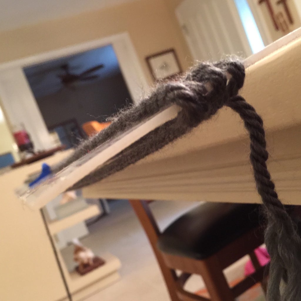 Starting at One Edge, Wrap Yarn Making Sure to Keep the Rows Parallel on the Sticky Tape. I Used the Entire Skein.