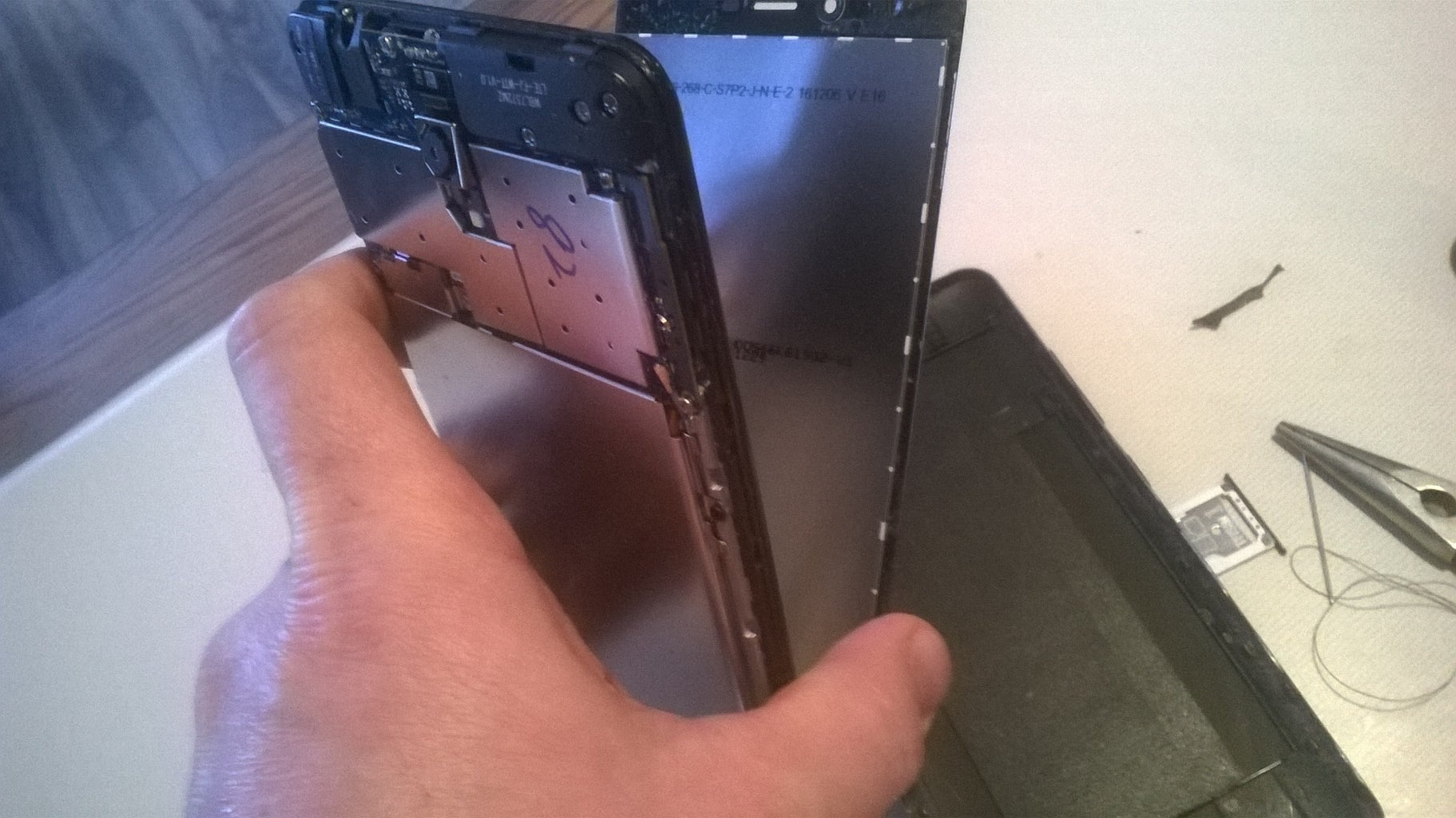 Remove the Back and Separate the Screen From the Rest of the Phone.