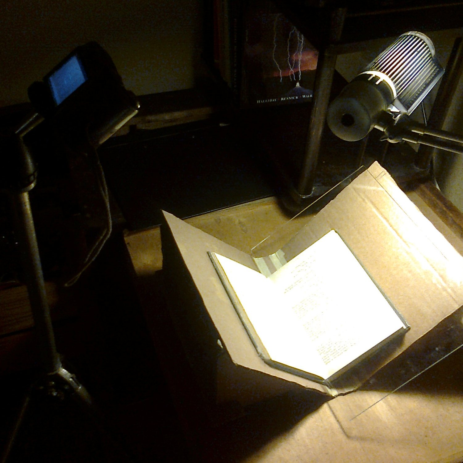 Foldable book stand for camera scanning